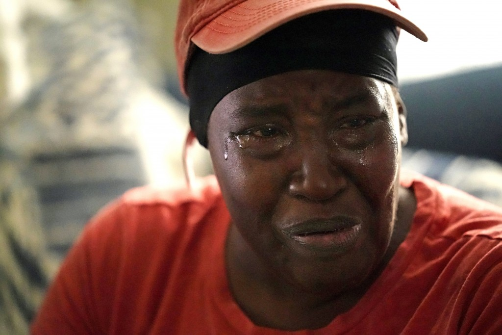 Natasha Blunt cries as she discusses her plight in her apartment in the aftermath of Hurricane Ida in Chalmette, La., Monday, Sept. 6, 2021. Before Id...