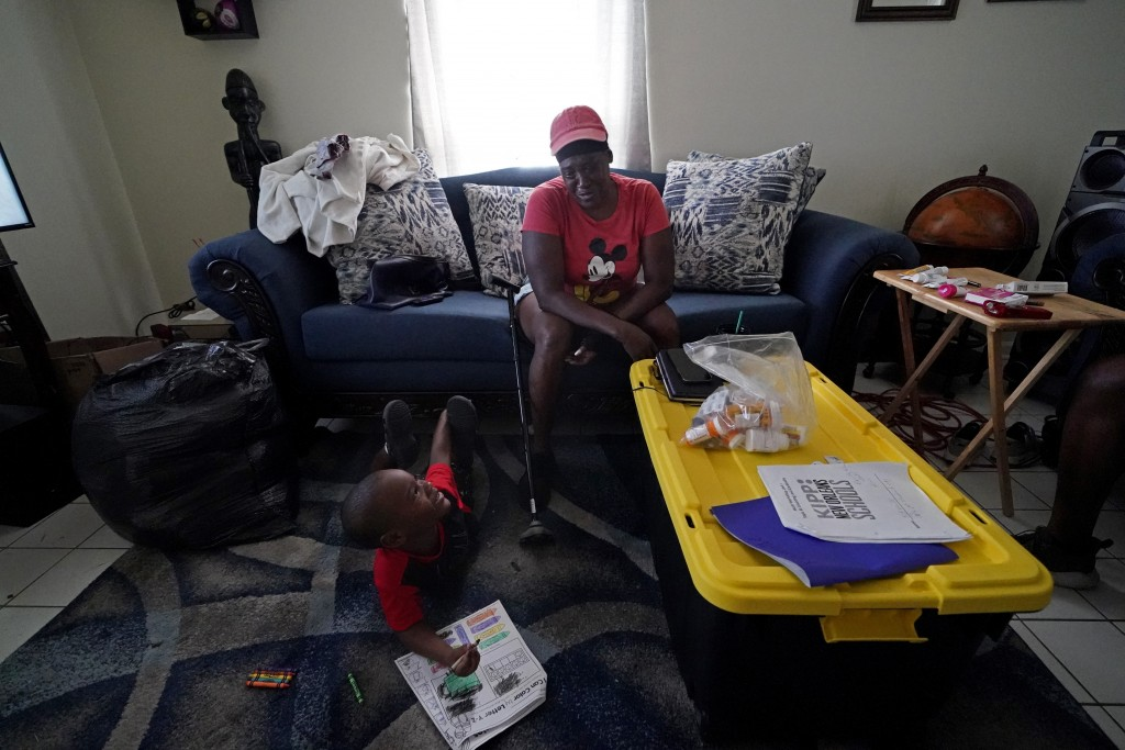 Natasha Blunt sits in her apartment with her grandson Kamille Blunt, 5, in the aftermath of Hurricane Ida in Chalmette, La., Monday, Sept. 6, 2021. Be...