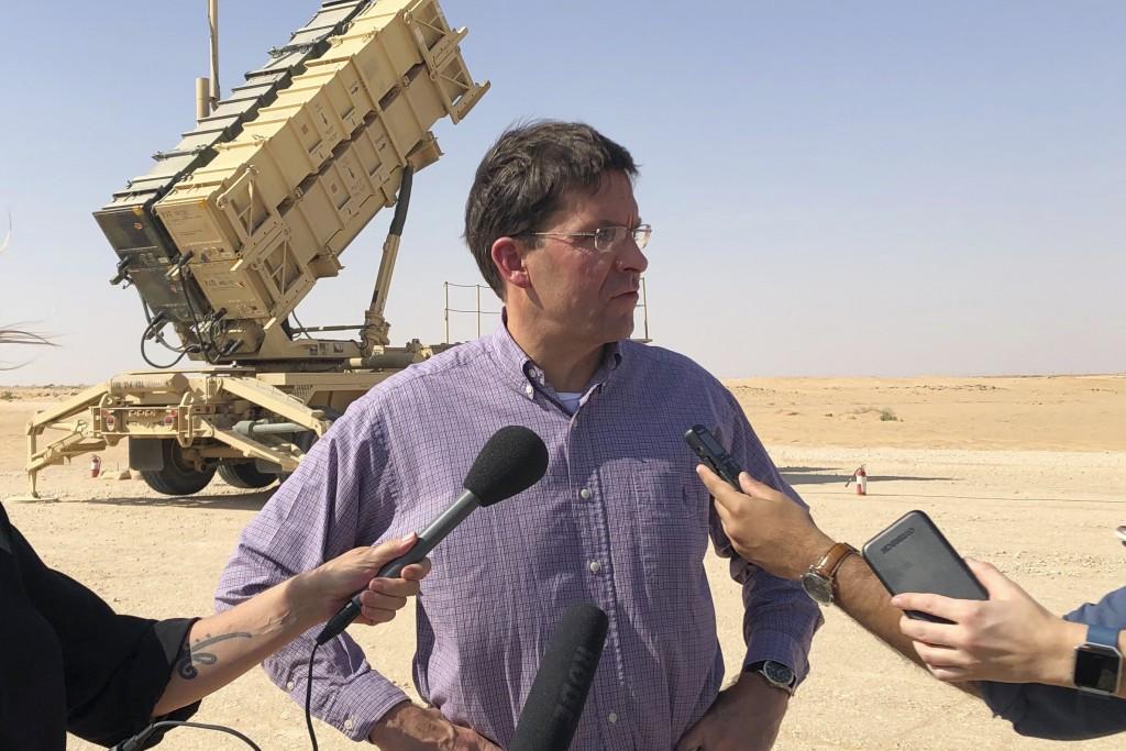 FILE - In this Oct. 22, 2019, file photo, then-U.S. Defense Secretary Mark Esper talks to reporters at Prince Sultan Air Base in Saudi Arabia. The U.S...