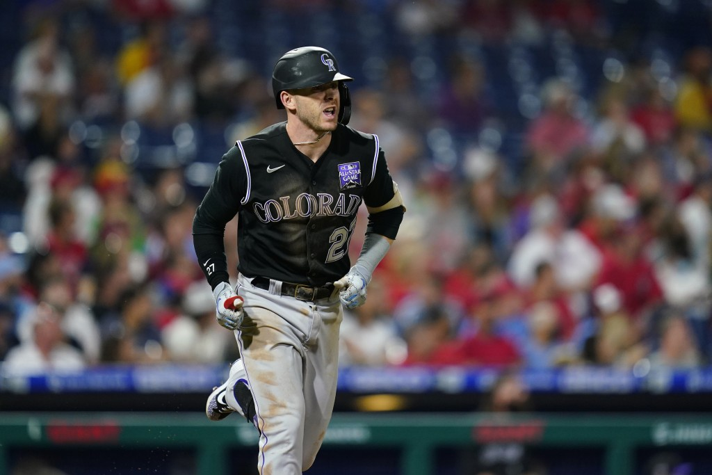 Colorado Rockies' Trevor Story reacts after hitting a home run against Philadelphia Phillies pitcher Zack Wheeler during the sixth inning of a basebal...