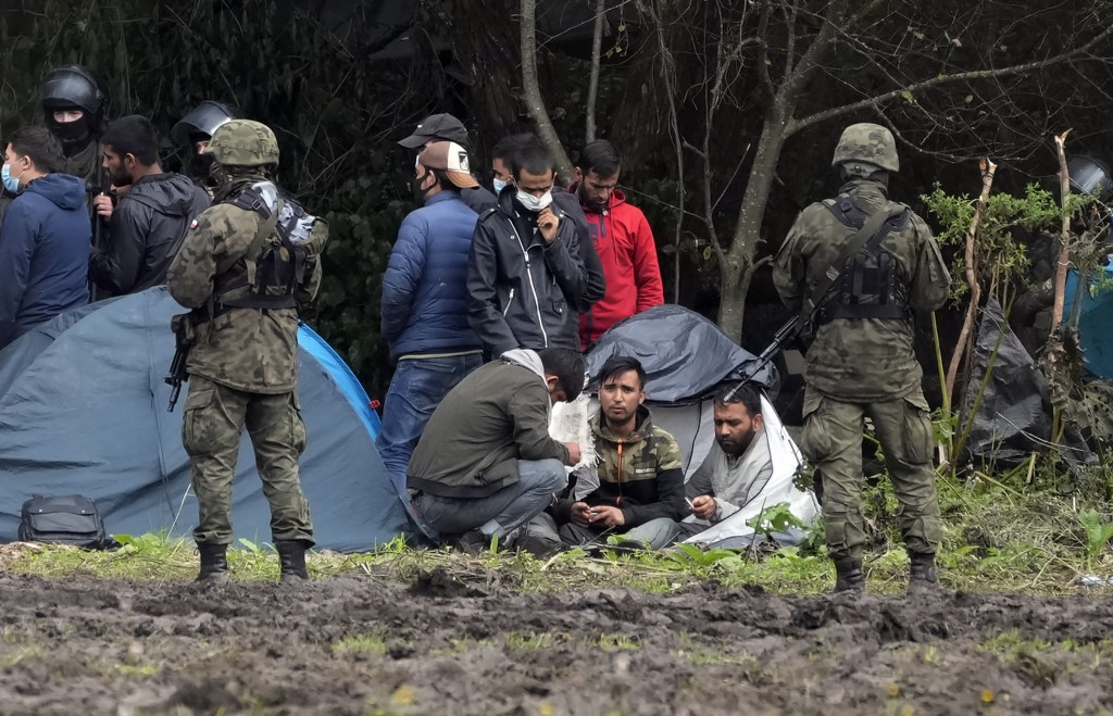 Polish security forces surround migrants stuck along with border with Belarus in Usnarz Gorny, Poland, on Wednesday, Sept. 1, 2021. Poland has been re...