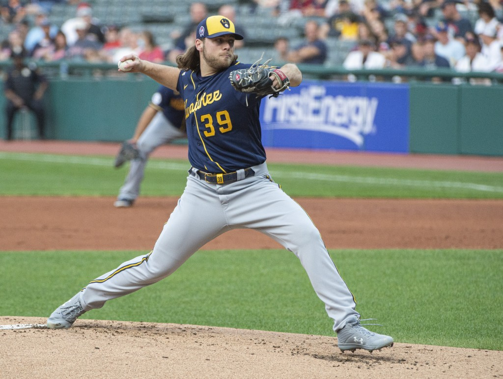 Milwaukee Brewers starting pitcher Corbin Burnes delivers against the Cleveland Indians during the first inning of a baseball game in Cleveland, Satur...