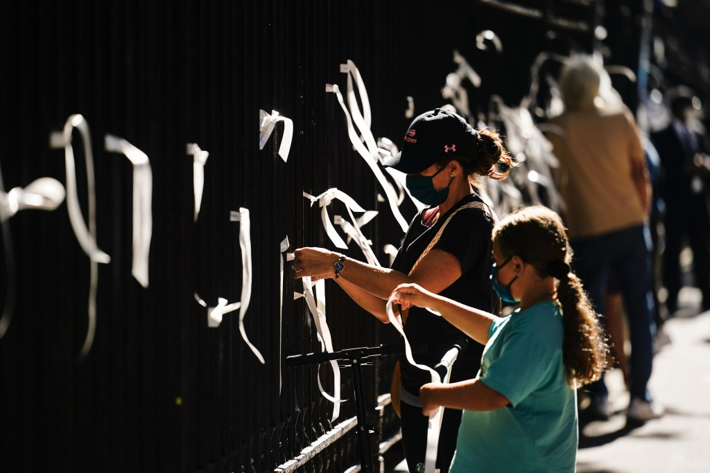 People tie ribbons to the fence at St. Paul's Chapel near the National September 11 Memorial & Museum during a ceremony marking the 20th anniversary o...