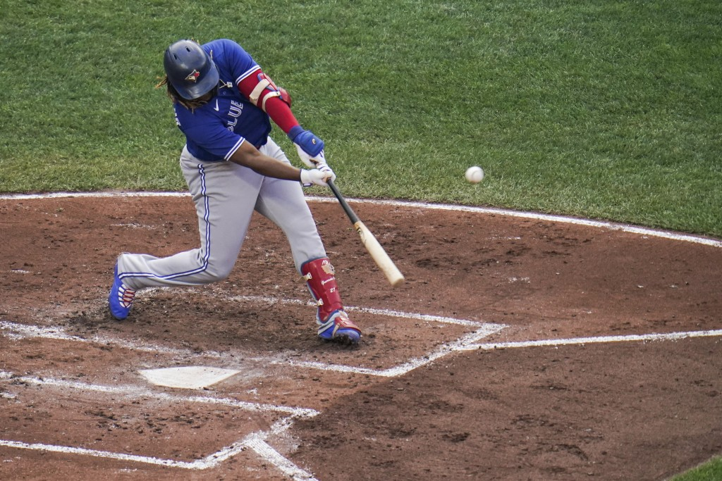 Toronto Blue Jays' Vladimir Guerrero Jr. connects for a solo home run off Baltimore Orioles starting pitcher Dean Kremer during the third inning of th...