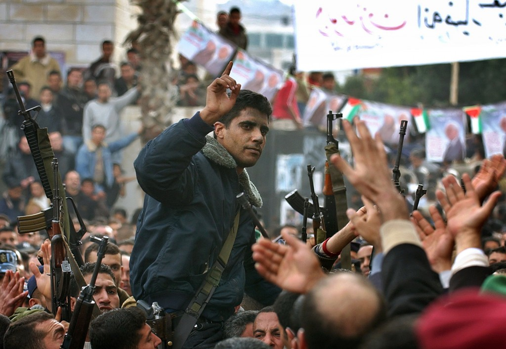 FILE - In this Dec. 30, 2004 file photo, Zakaria Zubeidi, then leader in the Al Aqsa Martyrs Brigade in the West Bank, is carried by supporters during...