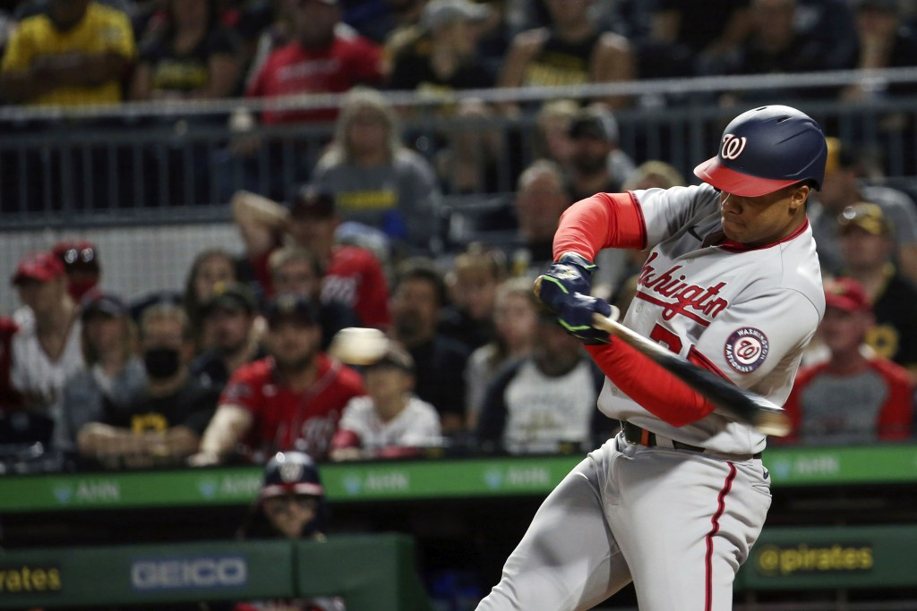 Washington Nationals' Juan Soto (22) hits an RBI single in the fifth inning of a baseball game against the Pittsburgh Pirates, Saturday, Sept. 11, 202...