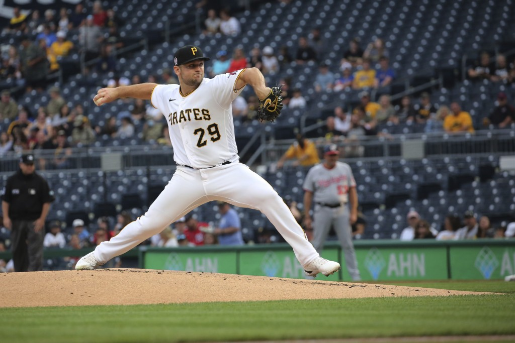 Pittsburgh Pirates' starter Wil Crowe pitches during the first inning of a baseball game against the Washington Nationals, Saturday, Sept. 11, 2021, i...