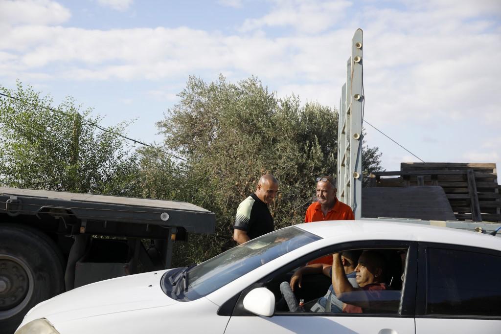 Locals gather near Palestinian fugitive Zakaria Zubeidi's hideouts in Umm al-Ghanam, northern Israel, Saturday, Sept. 11, 2021. Following Zubeidi's ar...