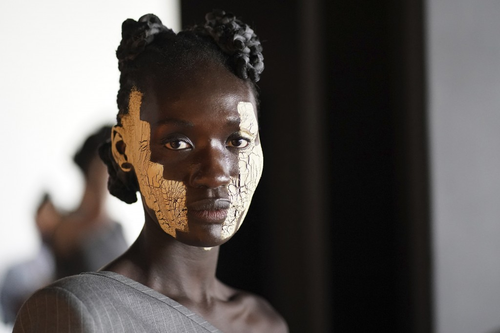 A model appears backstage in preparation for the Thom Browne fashion show during New York Fashion Week at The Shed, on Saturday, Sept. 11, 2021, in Ne...