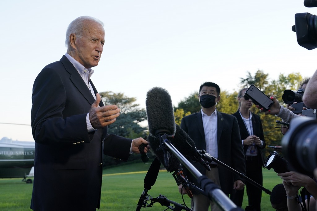 FILE - In this Sept. 7, 2021, file photo President Joe Biden talks with reporters after landing on Marine One on the South Lawn of the White House in ...