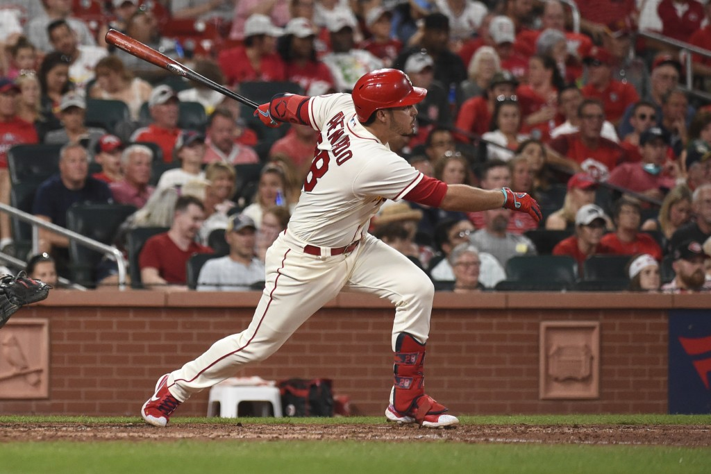 St. Louis Cardinals' Nolan Arenado watches his RBI-triple during the sixth inning of a baseball game against the Cincinnati Reds on Saturday, Sept. 11...