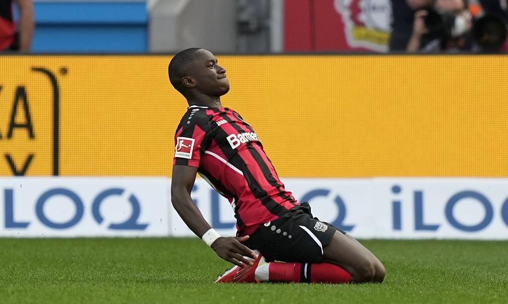 Leverkusen's Moussa Diaby celebrates after he scores his side's third goal during the German Bundesliga soccer match between Bayer Leverkusen and Boru...