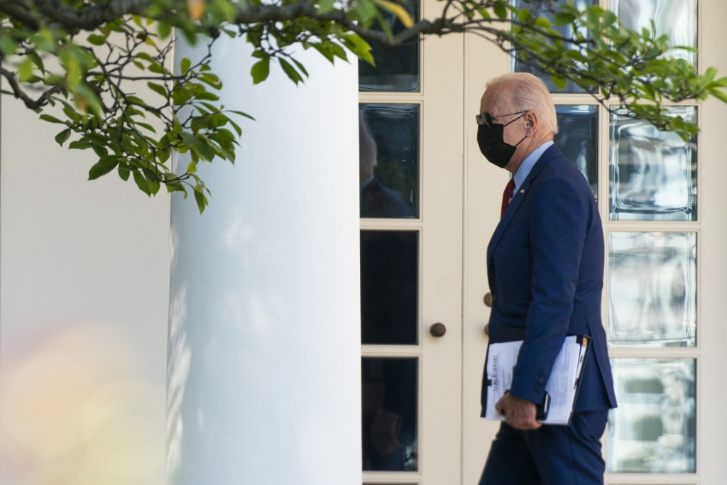 President Joe Biden walks along the Colonnade towards the Oval Office as he returns to the White House after visiting Brookland Middle School in north...