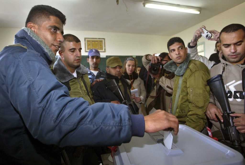 FILE - In this Jan. 9, 2005 file photo, Zakaria Zubeidi, then West Bank leader of Palestinian militant group Al Aqsa Martyrs Brigades votes during the...