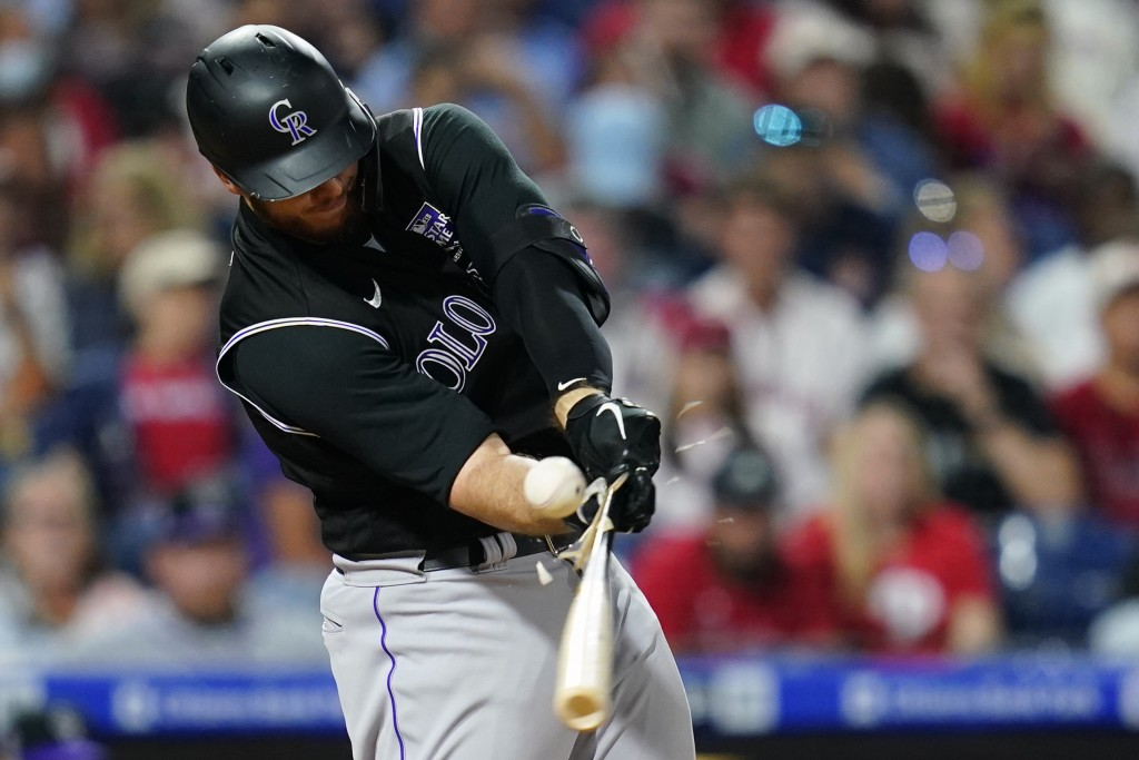 Colorado Rockies' C.J. Cron breaks his bat on a line out against Philadelphia Phillies pitcher Zack Wheeler during the sixth inning of a baseball game...