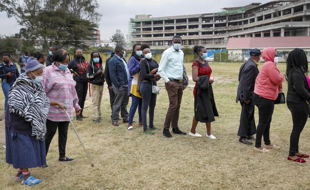Kenya queue up to receive the AstraZeneca coronavirus vaccine, at Kenyatta National Hospital in Nairobi, Kenya Thursday, Aug. 26, 2021. (AP Photo/Bria...