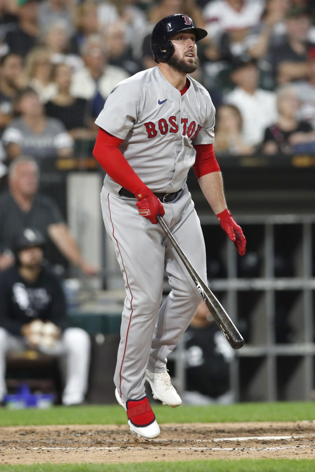 Boston Red Sox's Travis Shaw, right, watches his three-run home run in the third inning against the Chicago White Sox during a baseball game, Saturday...