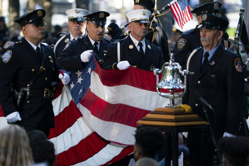 A memorial flag is brought onto the stage during ceremonies to commemorate the 20th anniversary of the Sept. 11 terrorist attacks, Saturday, Sept. 11,...