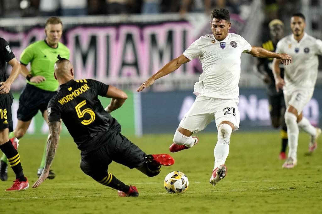 Inter Miami forward Julian Carranza (21) prepares to kick the ball as Columbus Crew defender Vito Wormgoor (5) defends during the second half of an ML...