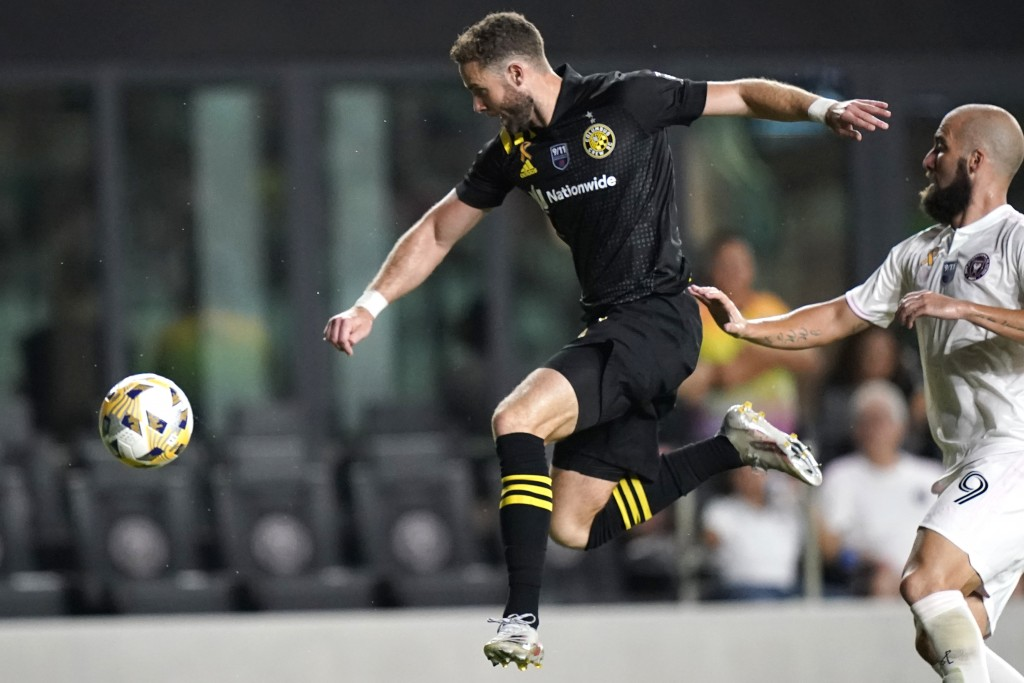 Columbus Crew defender Josh Williams, left, kicks the ball as Inter Miami forward Gonzalo Higuain (9) defends during the second half of an MLS soccer ...