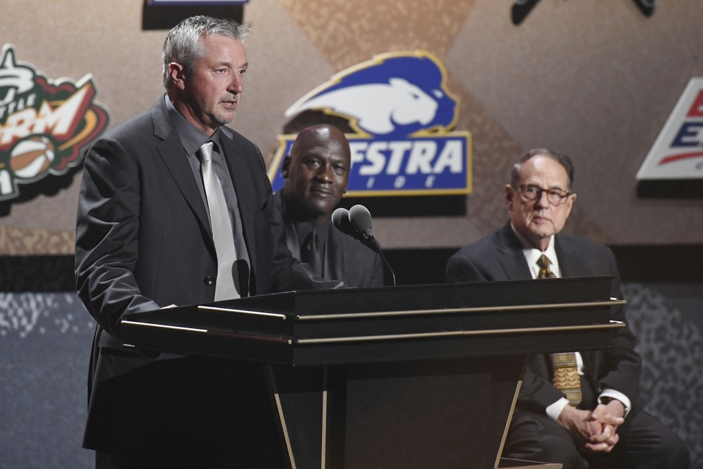 Inductee Toni Kukoc, left, speaks as teammate Michael Jordan and Jerry Reinsdorf, listen during the 2021 Basketball Hall of Fame Enshrinement ceremony...