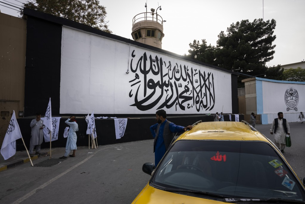 The iconic Taliban flag is painted on a wall outside the American embassy compound in Kabul, Afghanistan, Saturday, Sept. 11, 2021. (AP Photo/Bernat A...