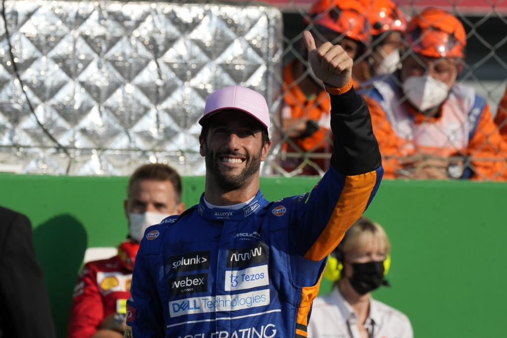 Mclaren driver Daniel Ricciardo of Australia salutes fans after taking third place in the Sprint Race qualifying session at the Monza racetrack, in Mo...