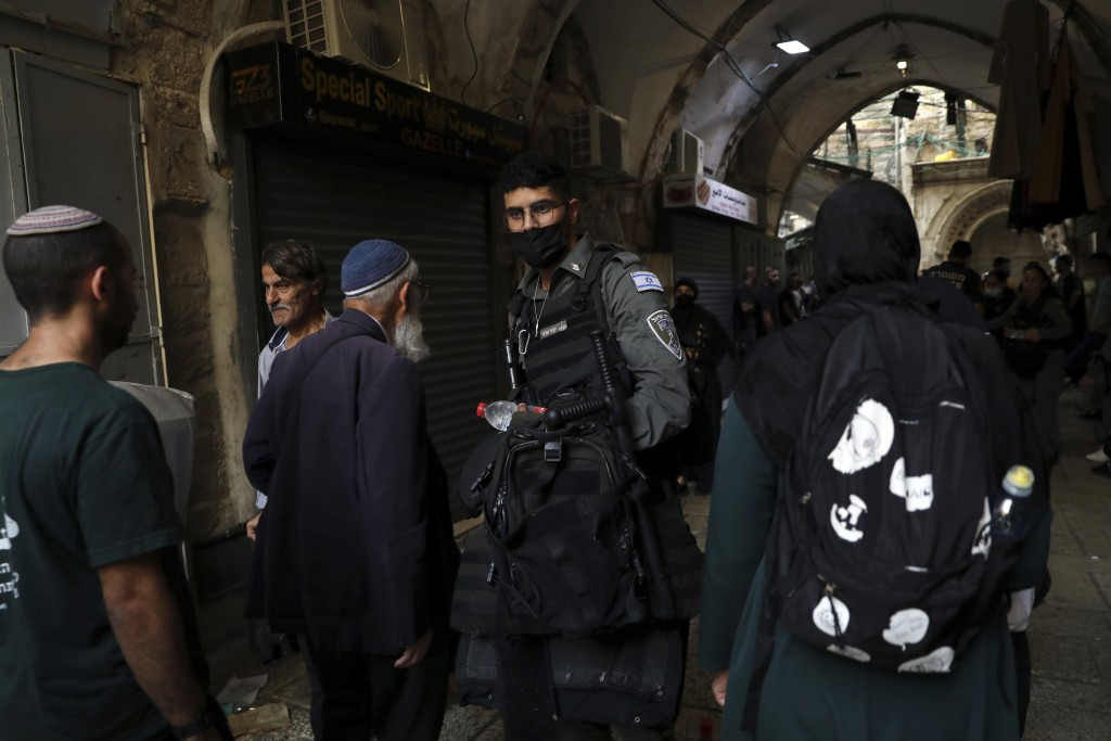 An Israeli border police officer works in the Old City of Jerusalem, Friday, Sept. 10, 2021. Amid increased Israeli-Palestinian tension over a recent ...