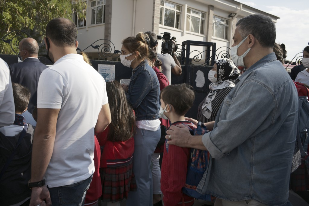 Pupils and parents arrive back at Cankaya Primary School in Turkish capital Ankara as schools reopen after 18 months' closure due to COVID-19, Monday,...