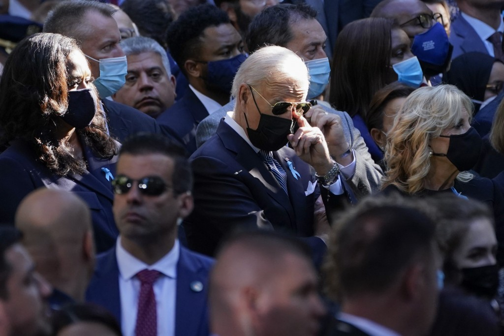 Formerfirst lady Michelle Obama, President Joe Biden and first lady Jill Biden attend a ceremony marking the 20th anniversary of the Sept. 11, 2001, ...