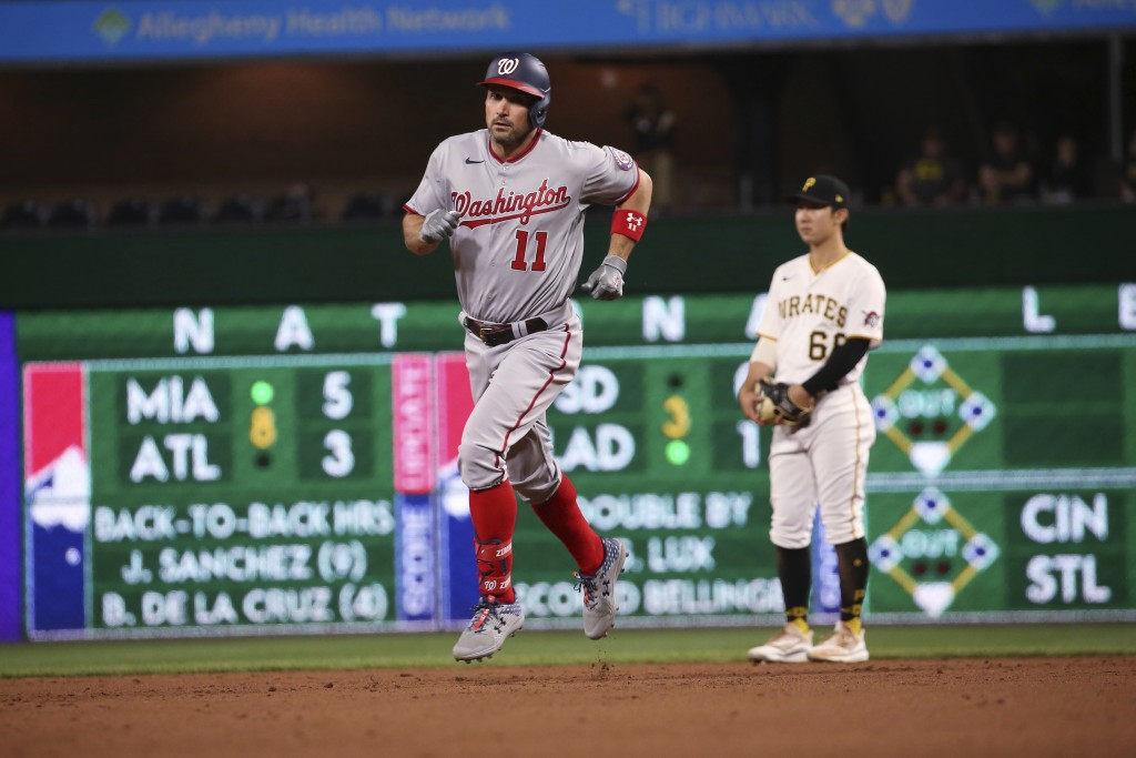 Washington Nationals' Ryan Zimmerman (11) runs the bases after hitting a home run in the eighth inning of a baseball game against the Pittsburgh Pirat...