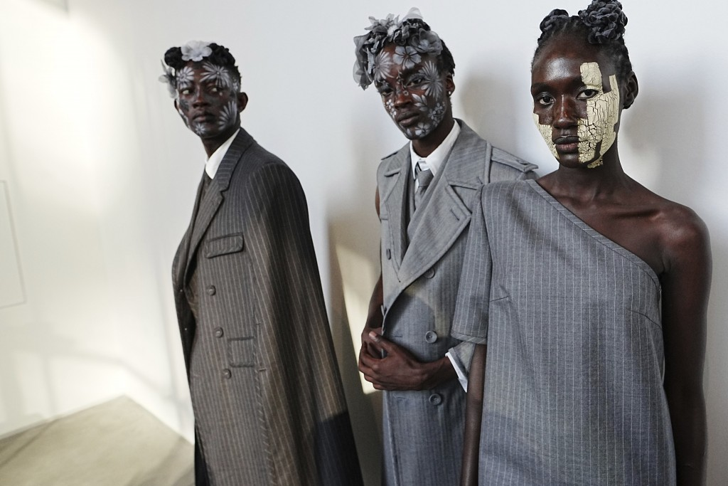Models appear backstage in preparation for the Thom Browne fashion show during New York Fashion Week at The Shed, on Saturday, Sept. 11, 2021, in New ...
