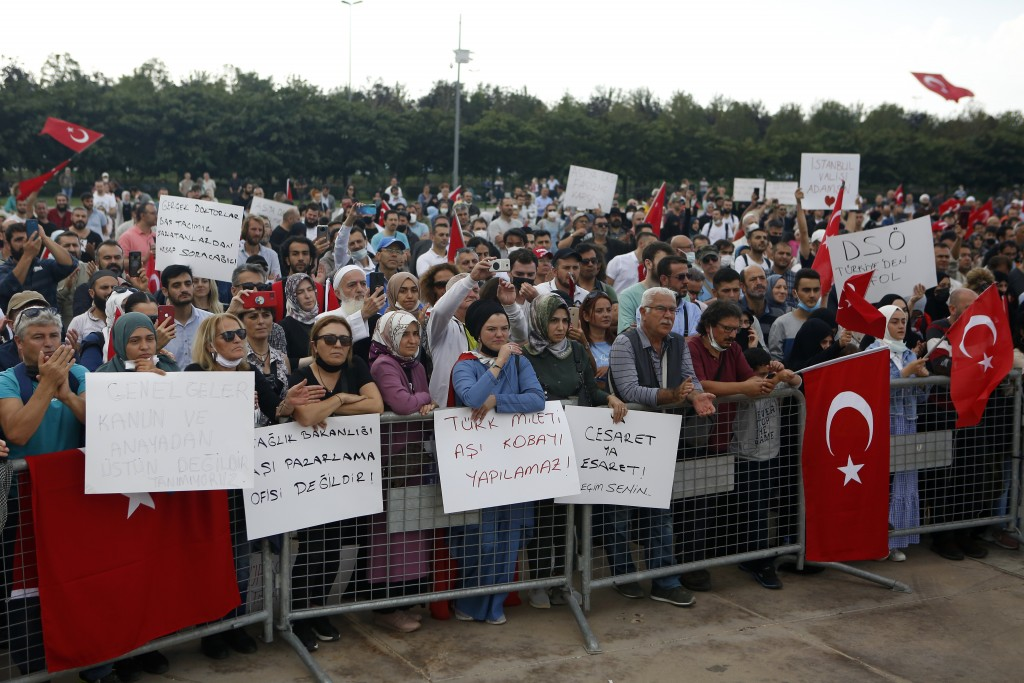 Thousands of people gather to protest COVID-19 precautions, in Istanbul, Saturday, Sept. 11, 2021. Unmasked crowds met in Maltepe, an open space on th...