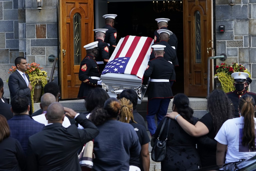 The casket of Sgt. Johanny Rosario Pichardo, a U.S. Marine who was among 13 service members killed in a suicide bombing in Afghanistan, is carried int...