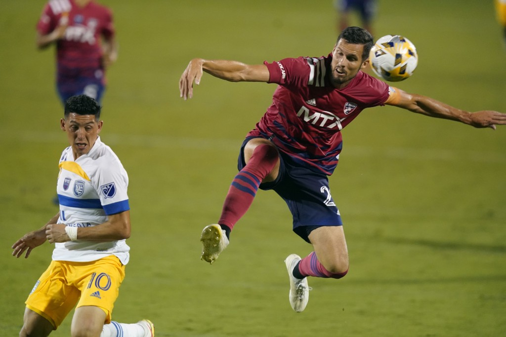 FC Dallas defender Matt Hedges (24) jumps for the ball against San Jose Earthquakes forward Cristian Espinoza (10) during the second half of an MLS so...