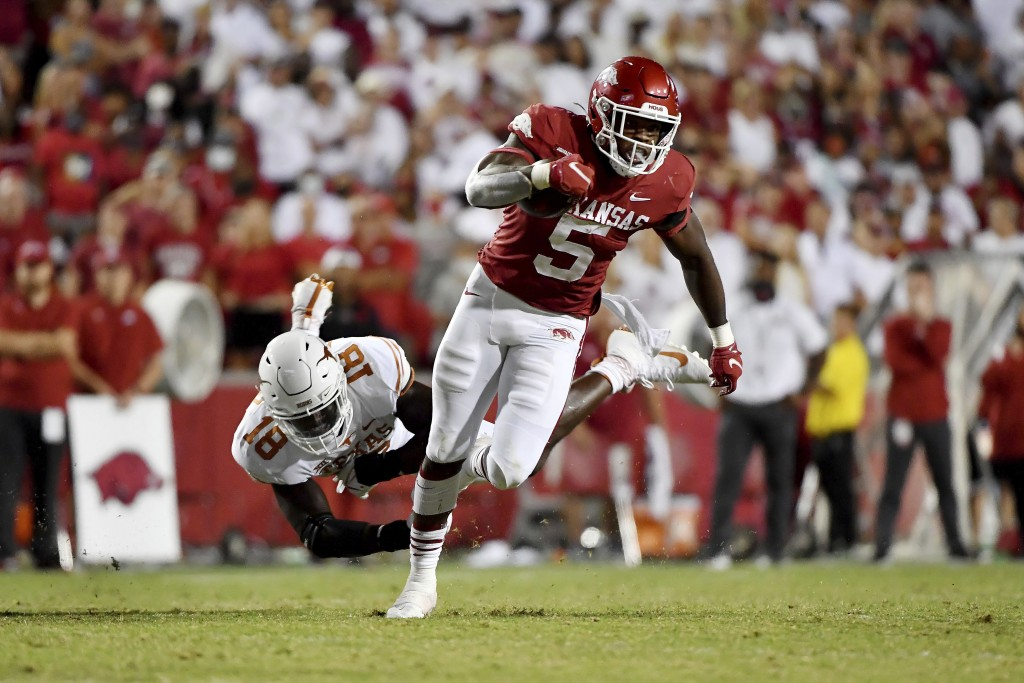 Arkansas running back Raheim Sanders (5) sheds Texas defender Ovie Oghoufo (18) as he runs for a touchdown during the second half of an NCAA college f...