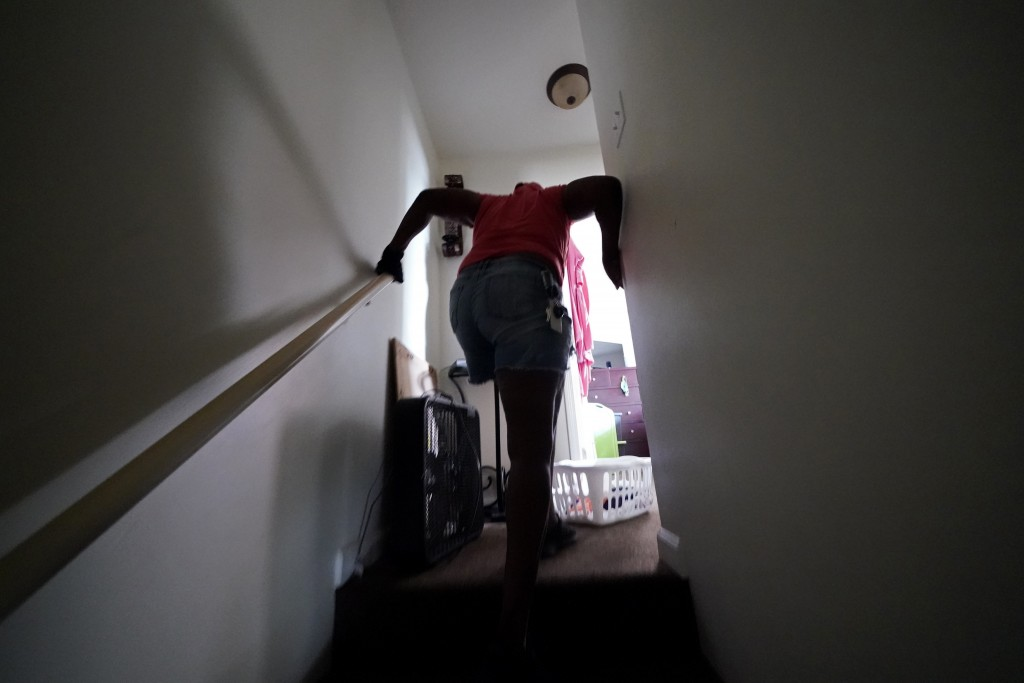 Natasha Blunt climbs up the stairs of her apartment in the aftermath of Hurricane Ida in Chalmette, La., Monday, Sept. 6, 2021. Before Ida hit, the Ne...