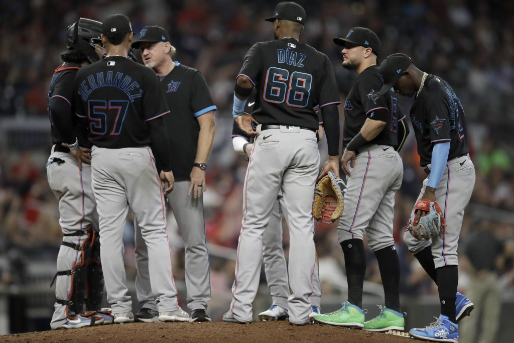 Miami Marlins pitcher Elieser Hernandez (57) meets with players and coaching staff in the fifth inning of a baseball game against the Atlanta Braves S...