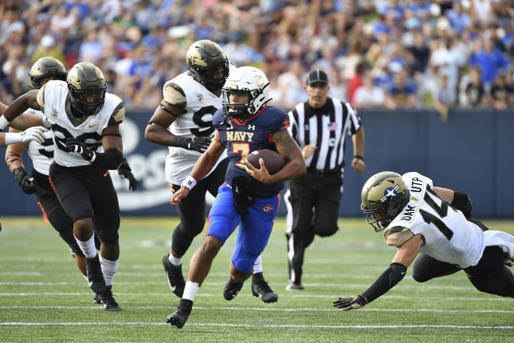 Navy quarterback Xavier Arline (7) runs the ball during the second half of an NCAA college football game against Air Force, Saturday, Sept. 11, 2021, ...