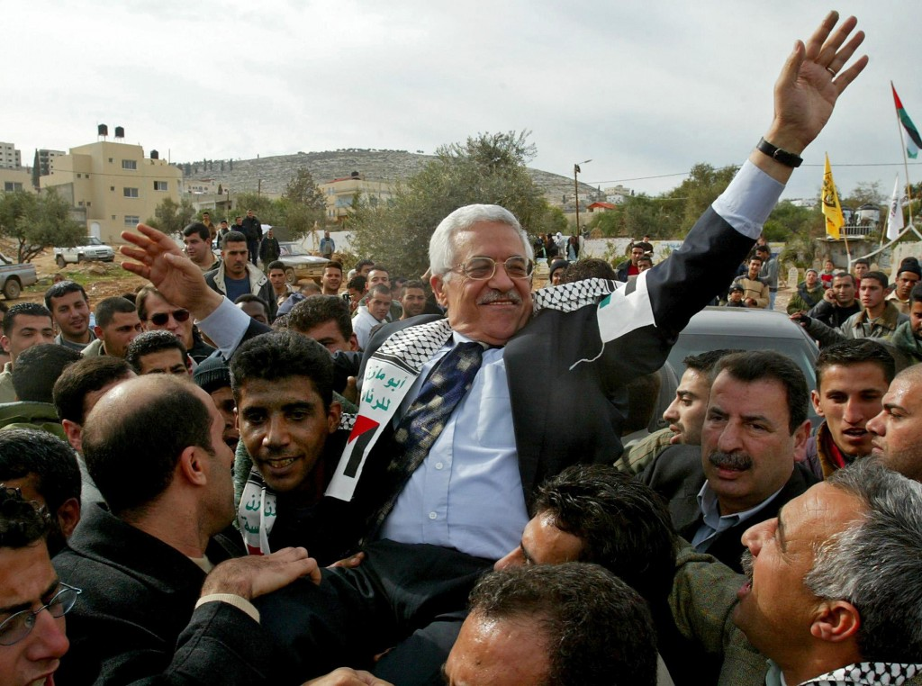 FILE - In this Dec. 30, 2004 file photo, then Interim Palestinian leader Mahmoud Abbas, and front-runner in the upcoming presidential elections, is ca...