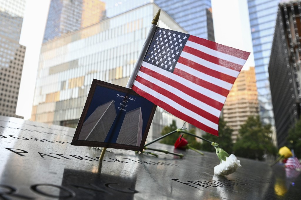 An American flag placed along with a photo of the Twin Towers and the name Daniel P. Trant, a Cantor Fitzgerald bond trader that died during 9/11, bef...