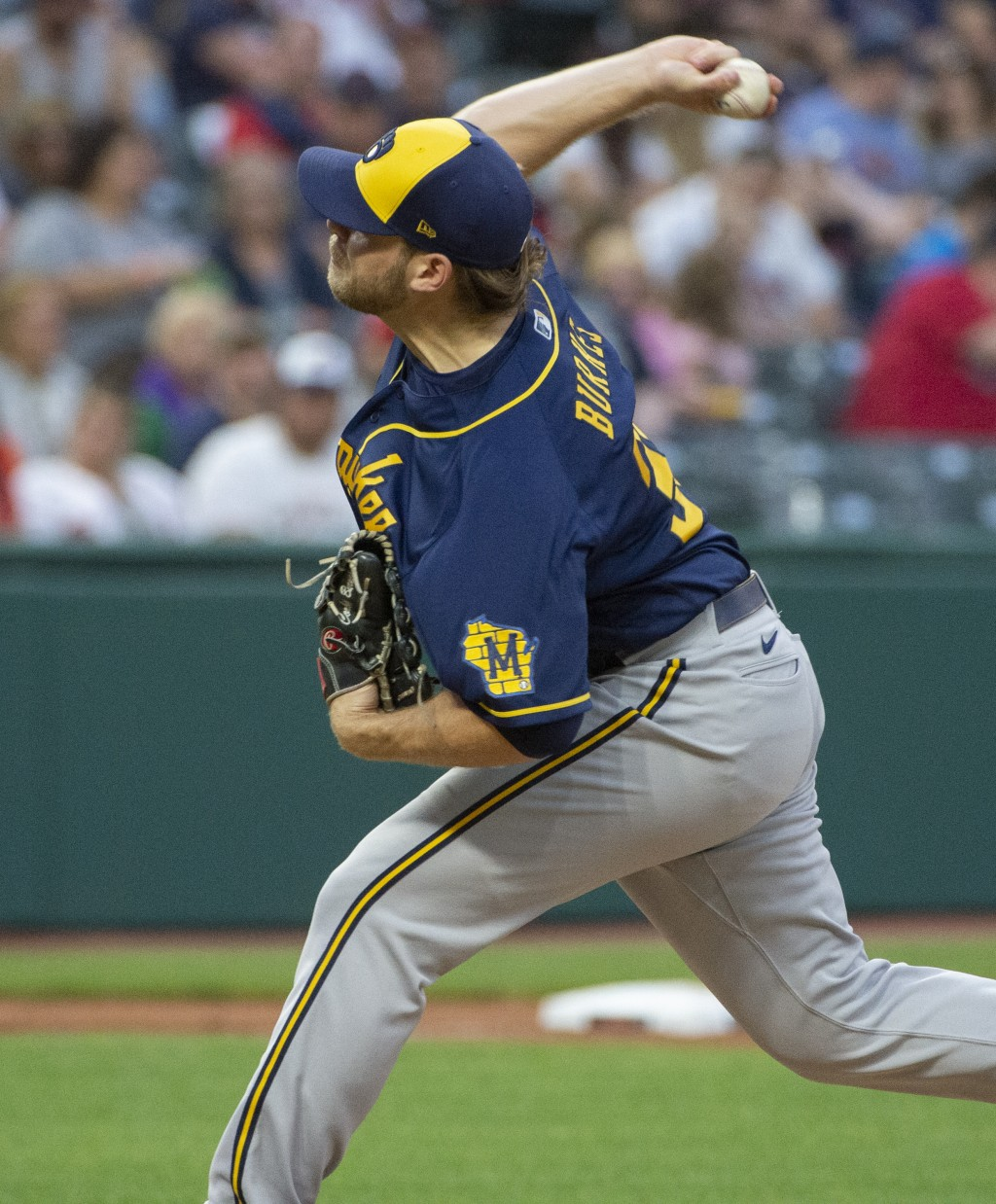 Milwaukee Brewers starting pitcher Corbin Burnes throws to strike out Cleveland Indians' Franmil Reyes during the fifth inning of a baseball game in C...