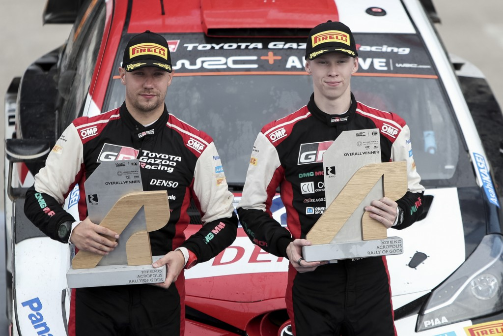 Kalle Rovanpera, right, and his co-driver Jonne Halttunen of Finland hold their trophies after winning the WRC Acropolis Rally, near Lamia, northwest ...