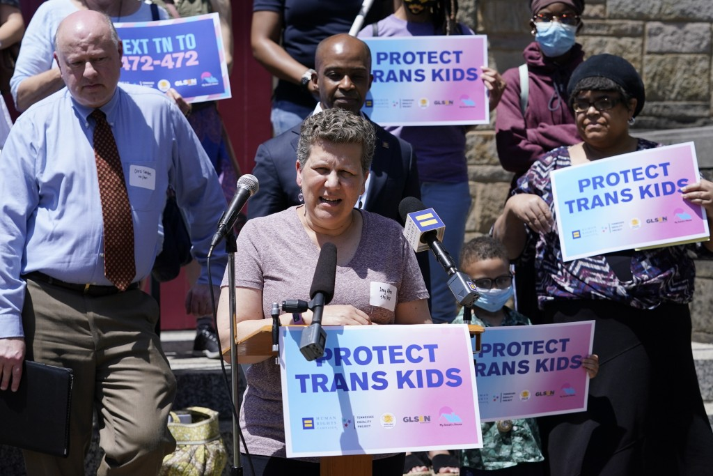 FILE - In this May 21, 2021, file photo, Amy Allen, the mother of an 8th grade transgender son, speaks after a Human Rights Campaign round table discu...
