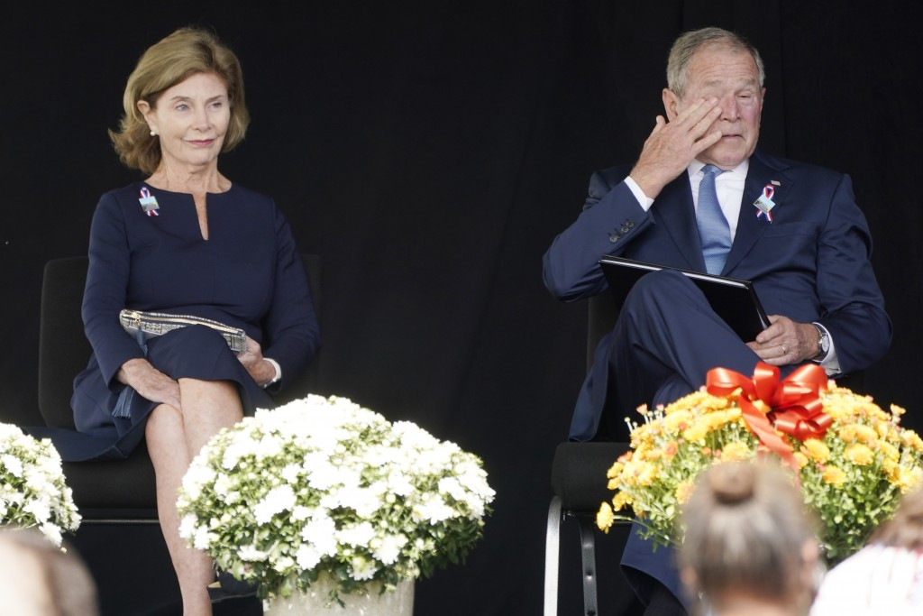 Former President George W. Bush, right, wipes his eyes next to former first lady Laura Bush, after he spoke at a memorial for the passengers and crew ...