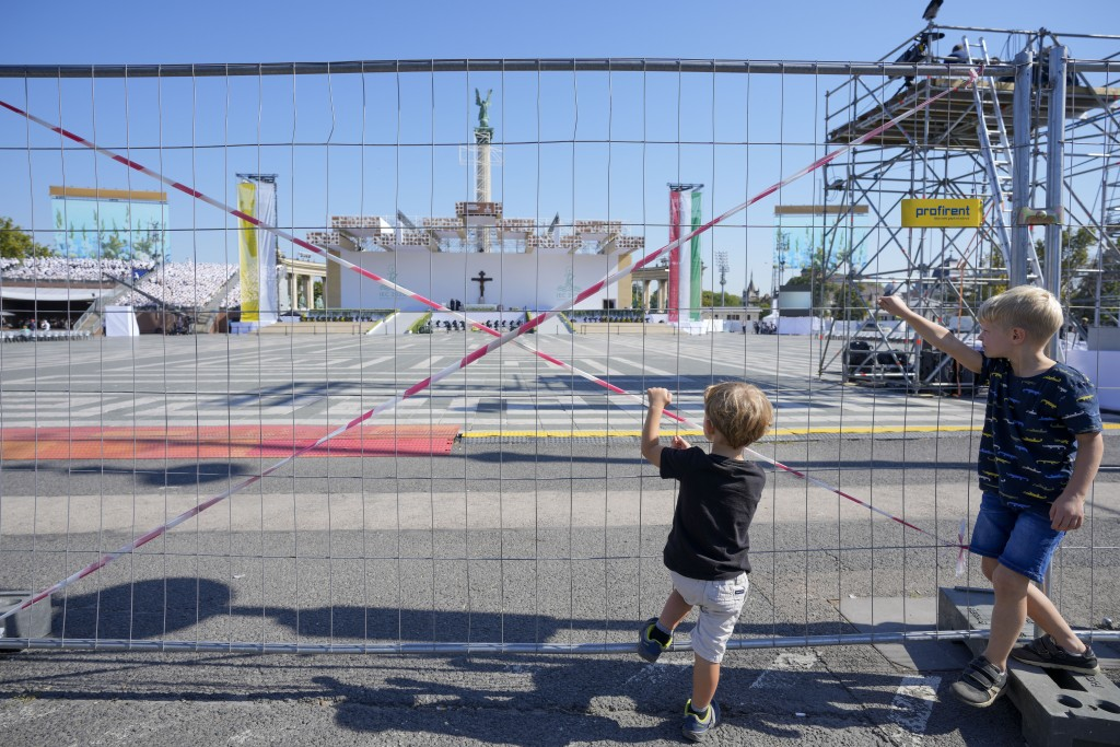 Children look at the fenced off area in Heroes' Square where Pope Francis will be celebrating mass, in Budapest, Hungary, Saturday, Sept. 11, 2021. Fr...