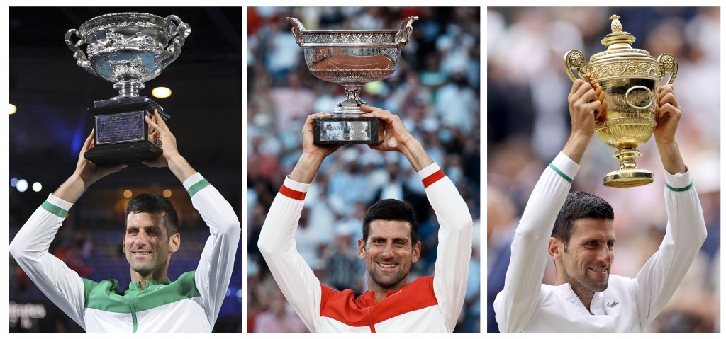 FILE- In this combo of 2021 file photos, Serbia's Novak Djokovic poses with the trophy after winning a Grand Slam tennis tournament, from left, Austra...