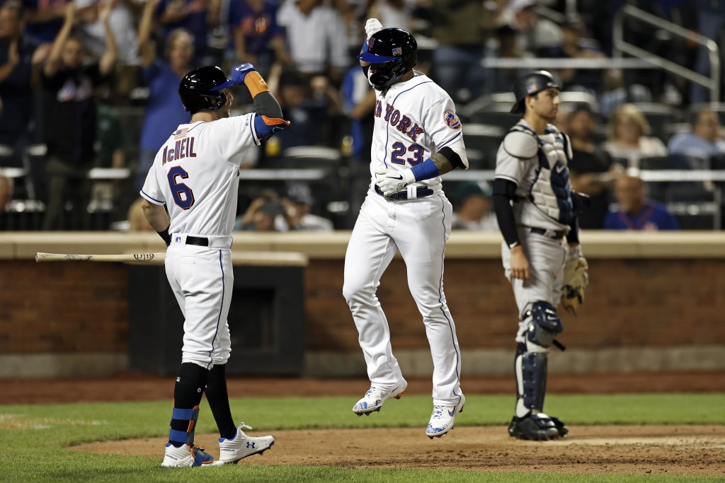 New York Mets' Javier Baez (23) celebrates with Jeff McNeil (6) after hitting a home run against the New York Yankees during the third inning of a bas...