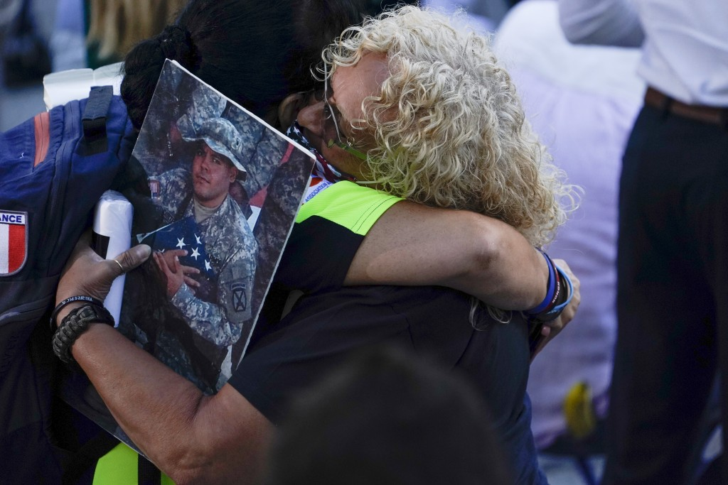 People react as they attend a ceremony marking the 20th anniversary of the Sept. 11, 2001, terrorist attacks at the National September 11 Memorial and...