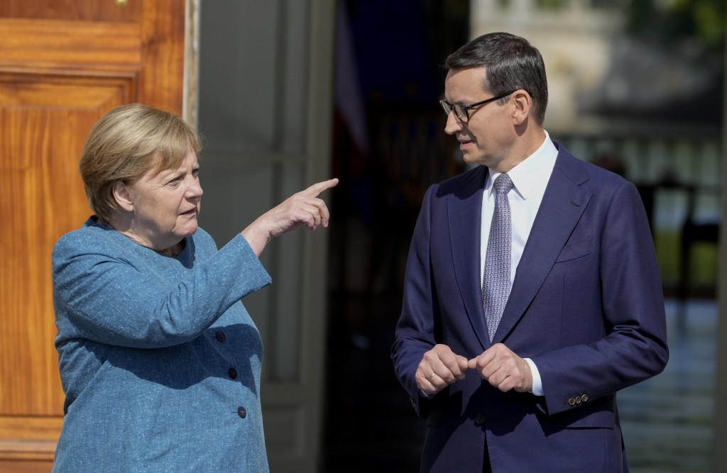 German Chancellor Angela Merkel, left, gestures as she meets Poland's Prime Minister Mateusz Morawiecki in Warsaw, Poland, Saturday, Sept.11, 2021.Mer...